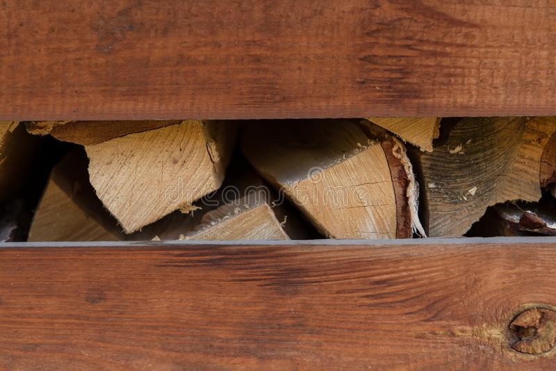 Storage of firewood in a country house. Typical country style royalty free stock images