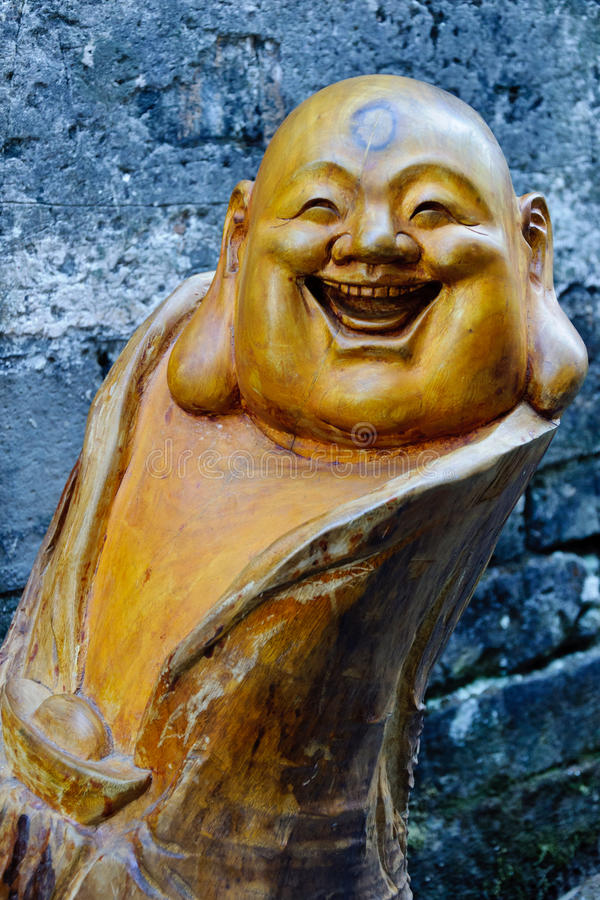 A wooden figure of buddha stock photo