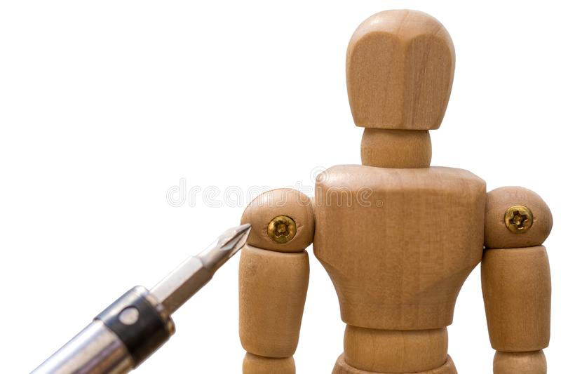 Wooden figure with screw in the shoulder and screwdriver as a symbol for treatment of the shoulder. Wooden figure in front of white wooden figure with screw in stock images