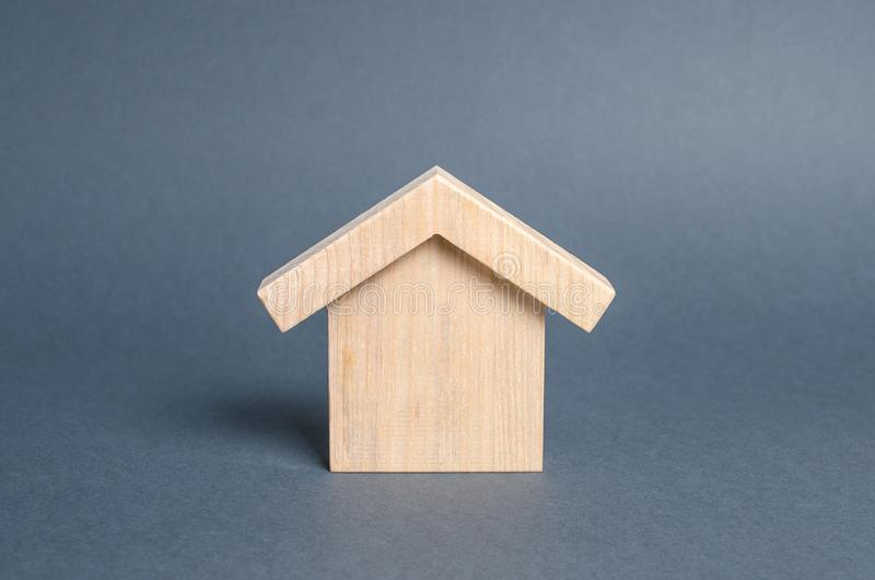 Wooden figure of a house. concept of buying and selling real estate, rent, investment. Home, Affordable housing, residential. Building. Construction buildings stock photography