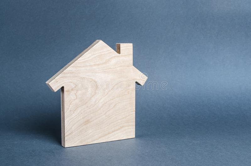 Wooden figure of a house. concept of buying and selling real estate, rent, investment. Home, Affordable housing, residential. Building. Construction buildings stock photo