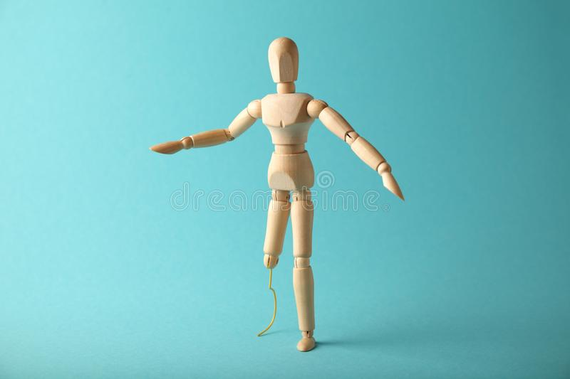 Wooden figure of man with artificial prosthetic leg. Amputee and disability concept stock photos