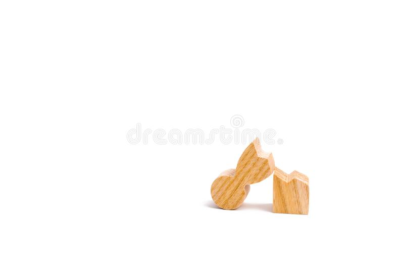 A wooden figure of a man is broken. The concept of psychological stress and pressure. Could not stand our nerves and our health. T royalty free stock photo