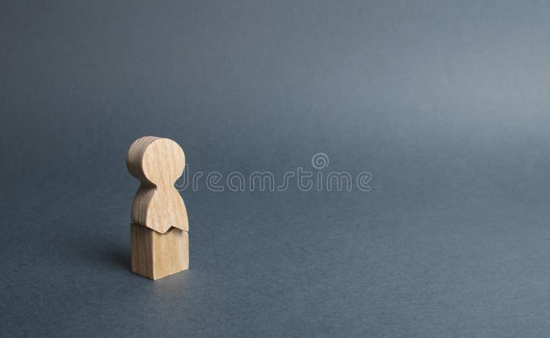 A wooden figure of a man with a crack. concept of psychological stress and pressure. Could not stand our nerves and our health. Threat of life. Injury and stock photos