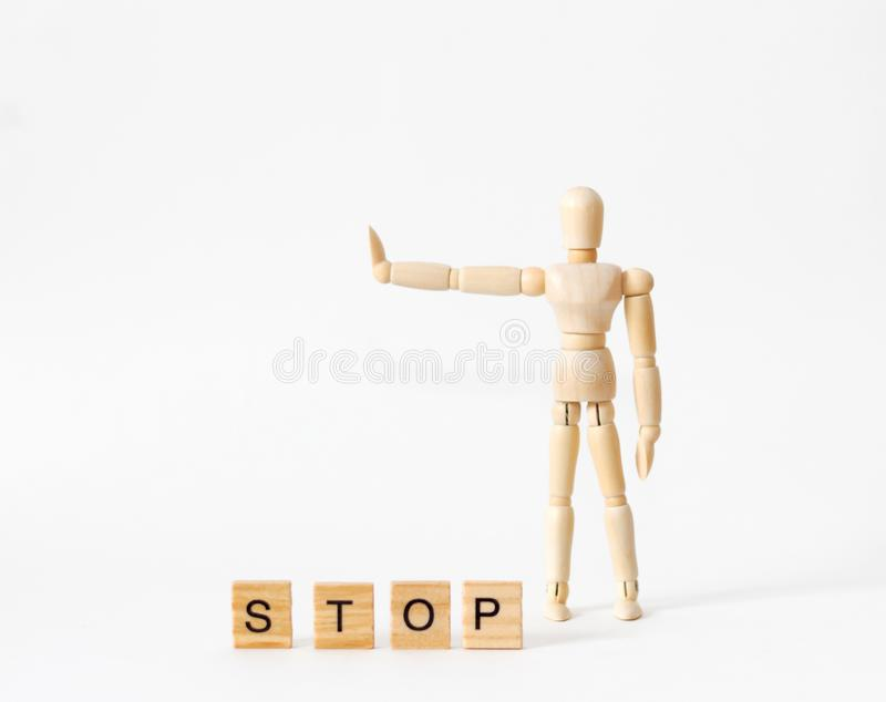 Wooden figure of a man shows stop. On white background royalty free stock photography