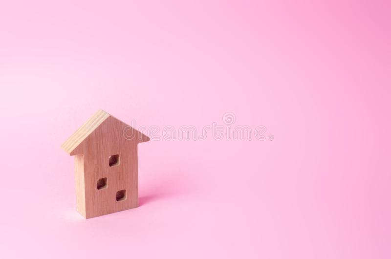 Wooden figure of a multi-storey house on a pink background. stock images