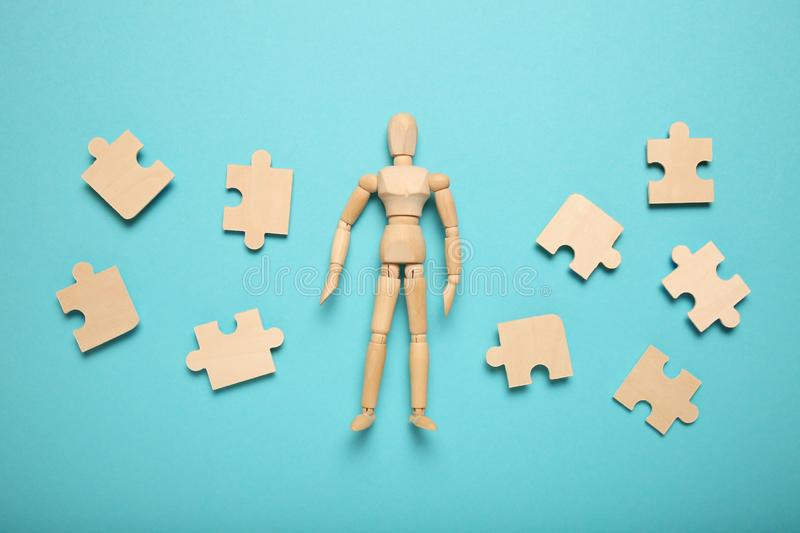 Wooden figure and puzzles, problem solving in business, new challenges. Innovation and teamwork.  stock images