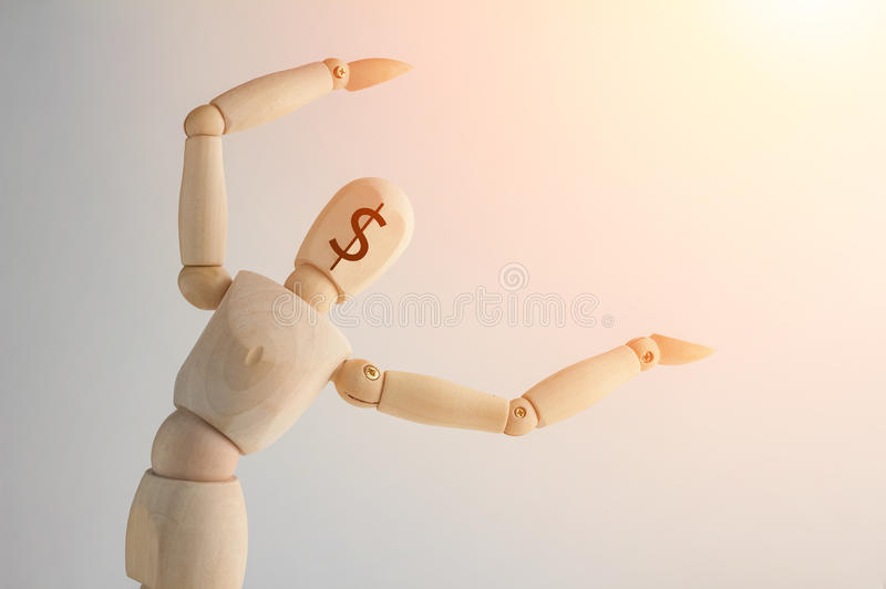 Wooden figure showing up blank space on white background. Wooden figure with money symbol on face showing up blank space on white background, copy space for your stock image
