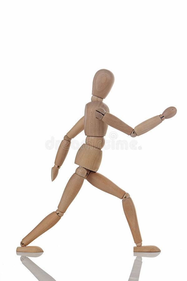 Wooden figure walking stock photography
