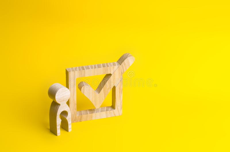A wooden figure of a woman with a void in the shape of a child s royalty free stock photos