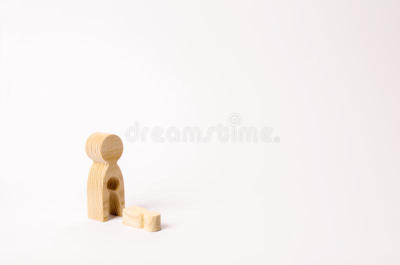 A wooden figure of a woman with a void from which a child fell. The concept of the loss of a child, abortion of pregnancy royalty free stock images