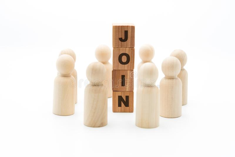 Wooden figures as business team in circle around word JOIN stock image