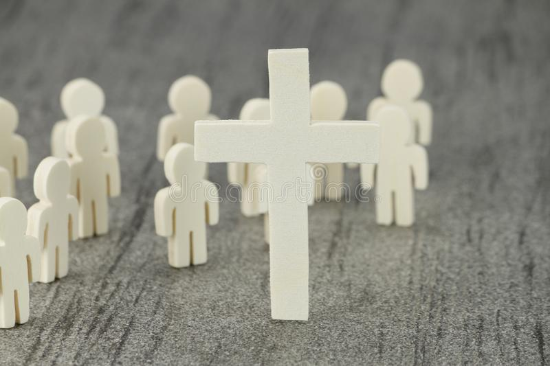 Wooden Figures with cross symbol. Several wooden figures with cross symbol A Christian community of faith royalty free stock image