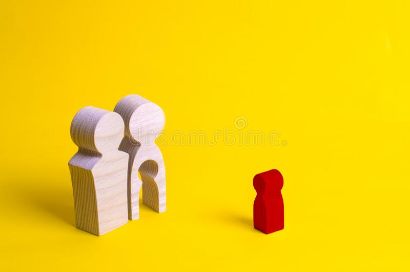 Wooden figures of a man and a woman with a void inside the body in the form of a child. Infertility in a couple. Loss of a single. Child. Medical problems. The stock images