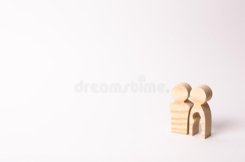 Wooden figures of a man and a woman with a void inside the body in the form of a child. Infertility in a couple stock photography