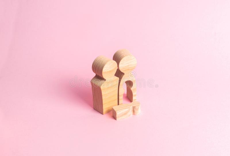 Wooden figures of a man and a woman with a void inside the body in the form of a child. Infertility in a couple. royalty free stock photos