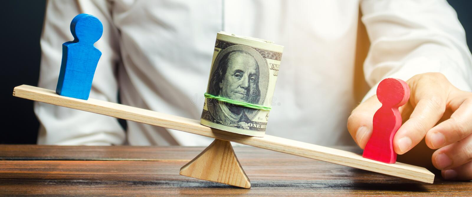 Wooden figures of man and women on the scales. Concept of gender pay gap. Income inequality. Oppression of women. Gender. Discrimination. Underestimation of stock photography