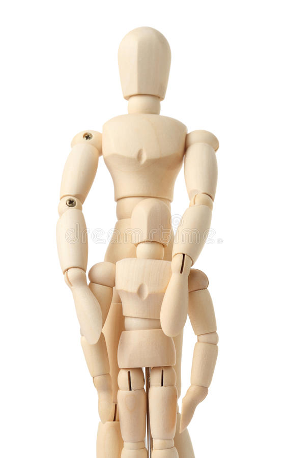 Wooden Figures Of Parent Embracing His Child Stock Image