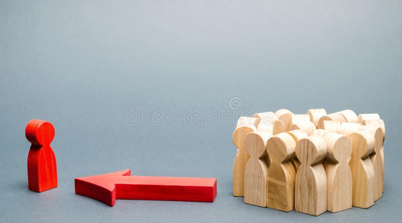 Wooden figures of people. The boss of the business team indicates the direction of movement to the goal. The crowd is following. The leader. The concept of royalty free stock images