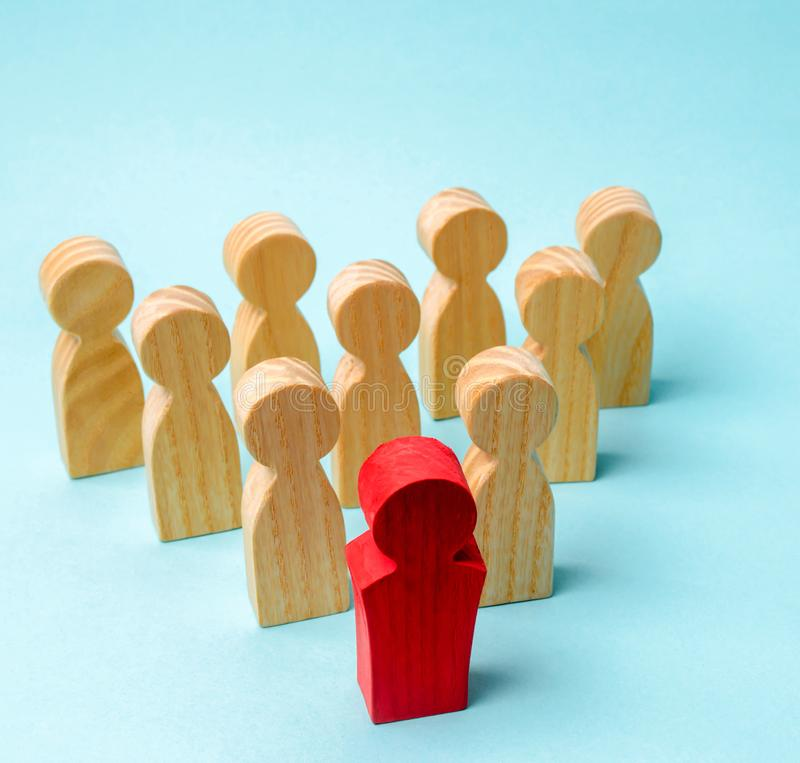 Wooden figures of people. The boss of the business team indicates the direction of movement to the goal. The crowd is following. The leader. The concept of royalty free stock photography