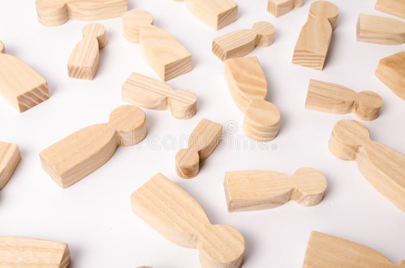 Wooden figures of people are lying on a white background. The concept of human resources management. Headhunters. royalty free stock photos
