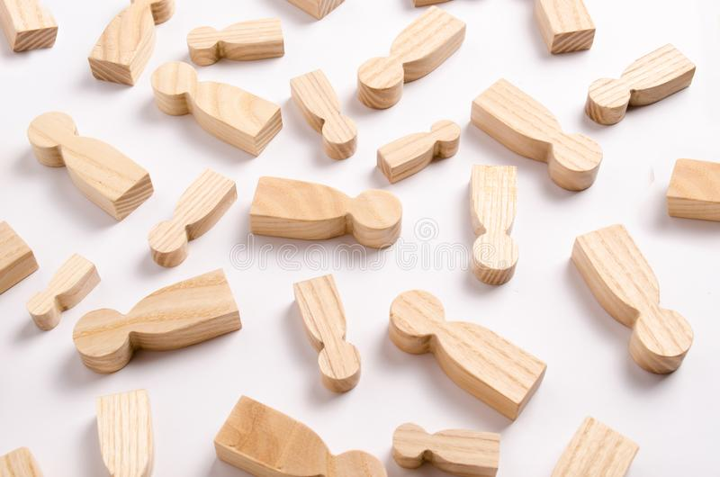 Wooden figures of people are lying on a white background. stock images