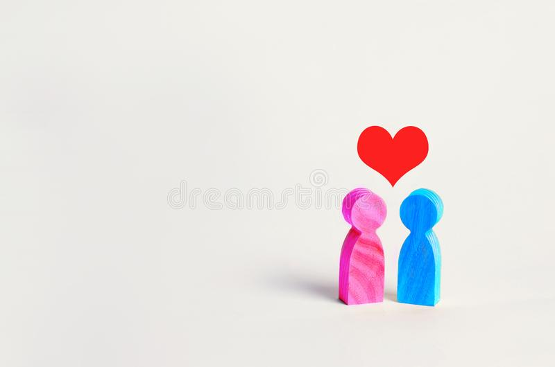 Wooden figures of people. Man and woman and heart over them. the concept of love. gender relations. couple of lovers. teenage feel royalty free stock photography