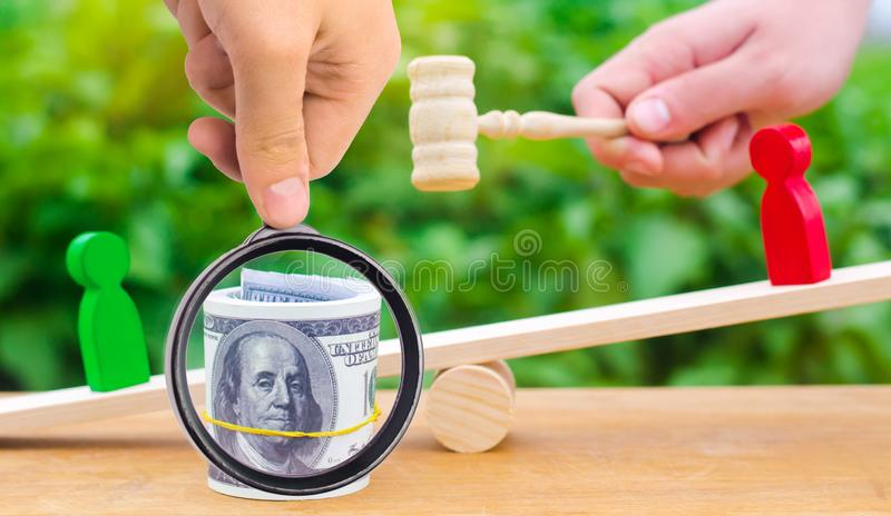 Wooden figures of people on scales and dollars between them. a d. Ispute between two businessmen. trial. debt restructuring. wage arrears. protection of employee stock photo