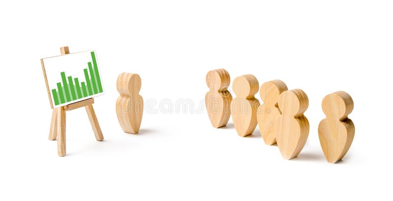 Wooden figures of people stand in the formation and listen to their leader. Business training, briefing and inspirational speech. royalty free stock image