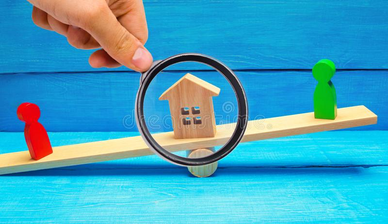 Wooden figures on the scales. clarification of ownership of the. House, real estate. court. rivals in business. competition. concept of success and power stock image