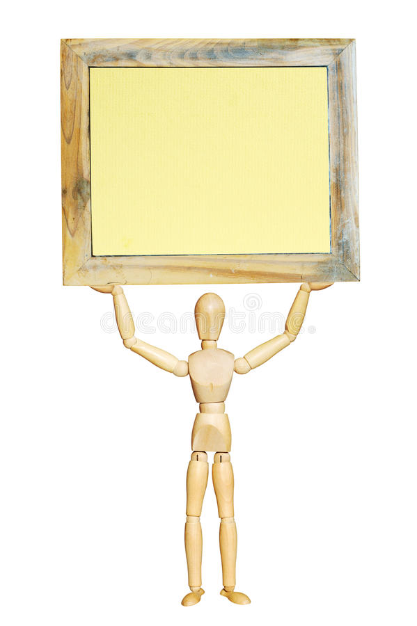 Wooden figurine holding a picture frame royalty free stock photography