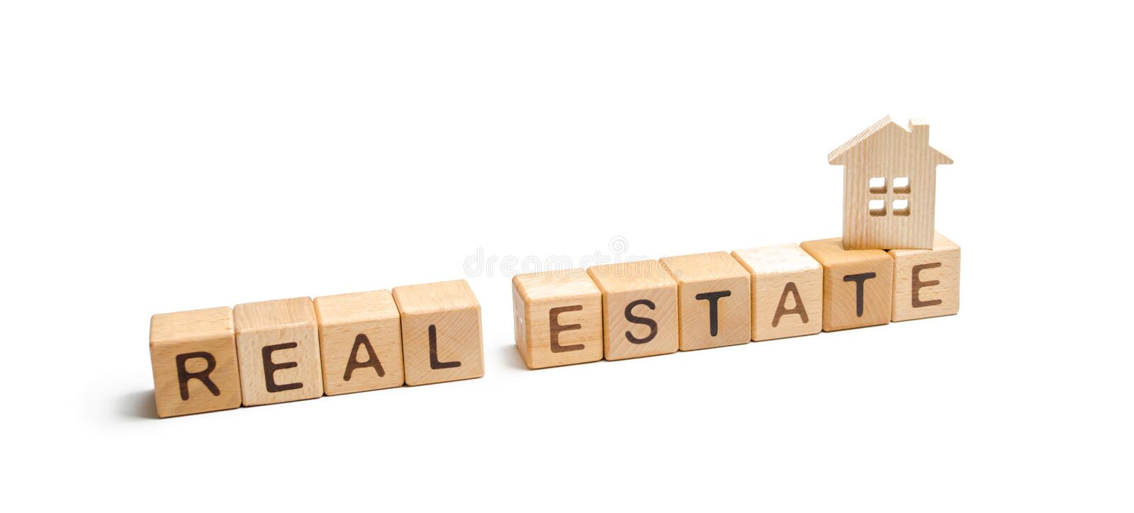 Wooden figurine of a house and cubes with the inscription real estate on a white background. acquisition and sale of housing stock images