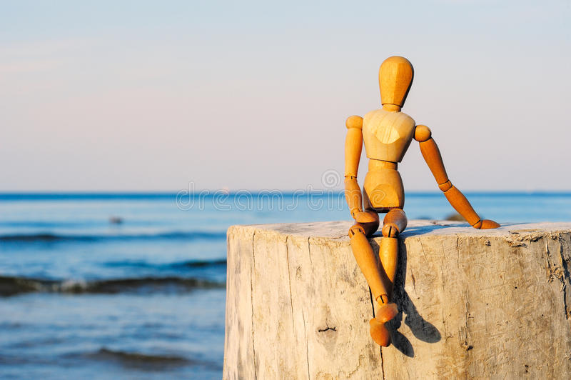 Wooden figurine stock images