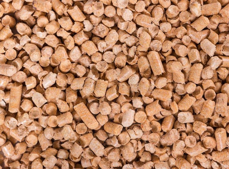 Wooden filler for cat litter stock images