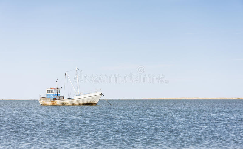 Wooden fishing boat in sea royalty free stock image