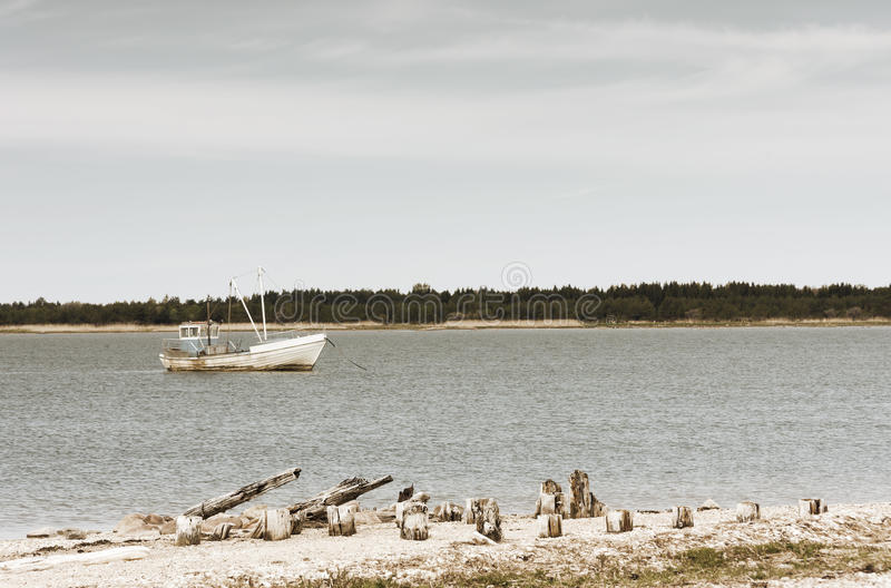 Wooden fishing boat in sea royalty free stock photo