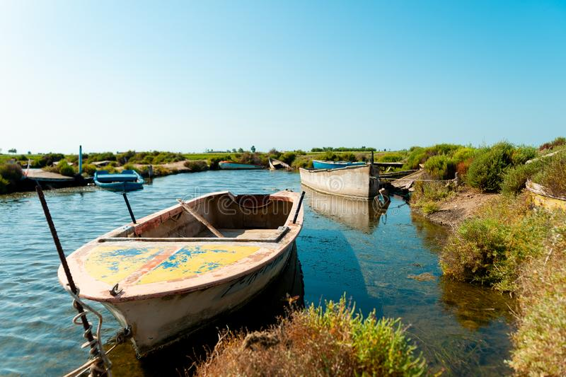 Traditional wooden fishing boats abandoned in ebro delta national park in catalonia, symbol of fishing problems and economic. Wooden fishing boats abandoned in stock photos