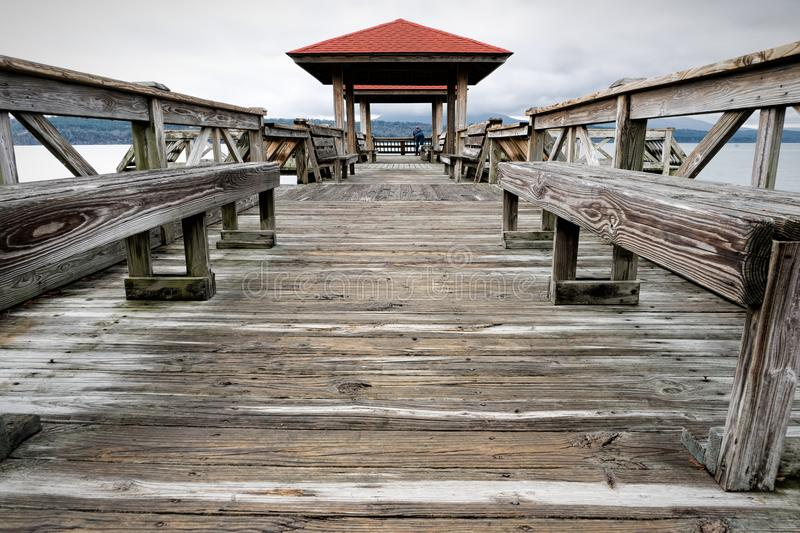 Fishing Pier at Lake Dardanelle with Person stock images