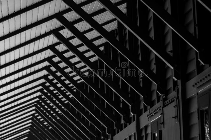 Wooden fixed awning and the walls of the building in Thai style along sidewalk of house. Black and white wooden awning structure. Exterior design of wood stock photo