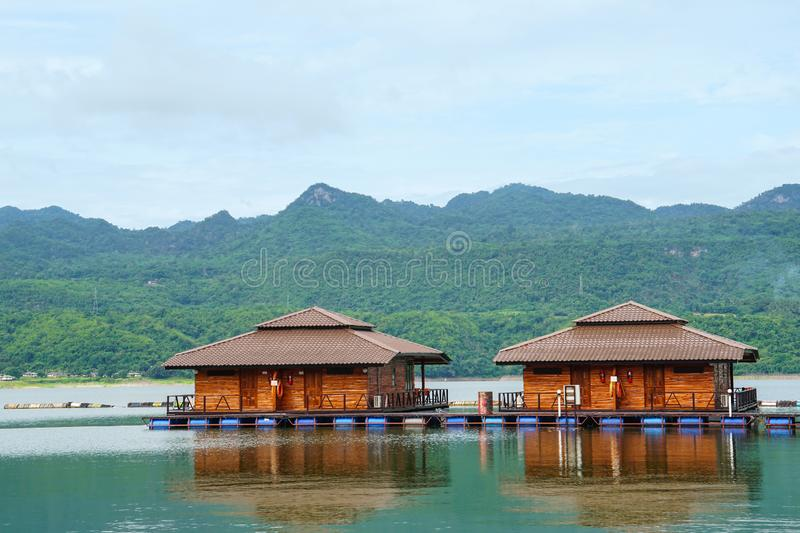 Wooden floating raft house resort by mountain Kanchanaburi, Thailand. Wooden floating raft house resort by mountain Kanchanaburi Thailand royalty free stock photos