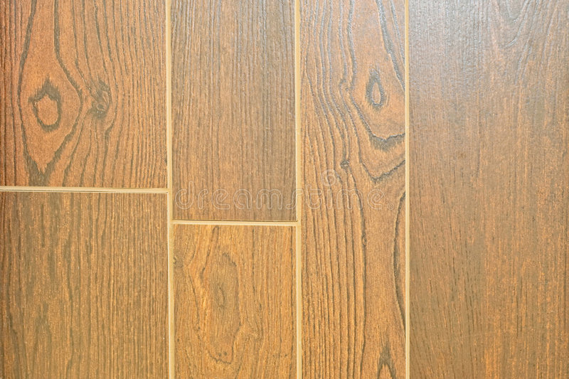 Wooden floor. Parallel dark wood texture on the floor royalty free stock image