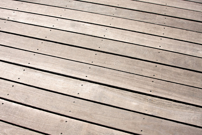 Wooden floor. Angle shot of wooden floor background texture royalty free stock photos