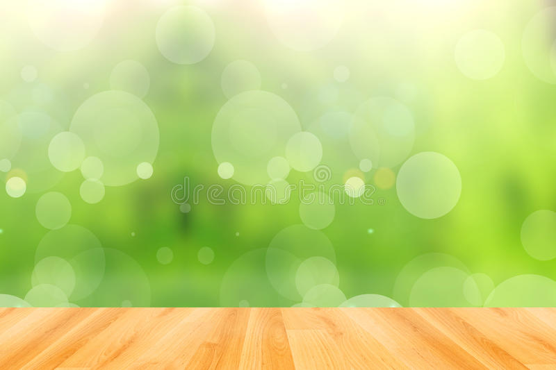 Wooden floor and abstract green bokeh background. Wood floor and abstract green bokeh background stock photo