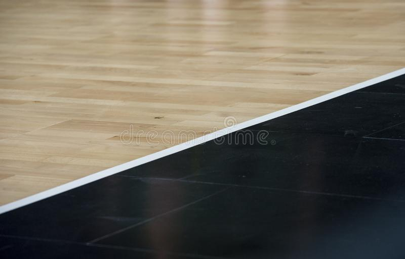 Wooden floor basketball arena. Wooden floor of sports hall with marking lines line on wooden floor indoor, gym court.  royalty free stock images