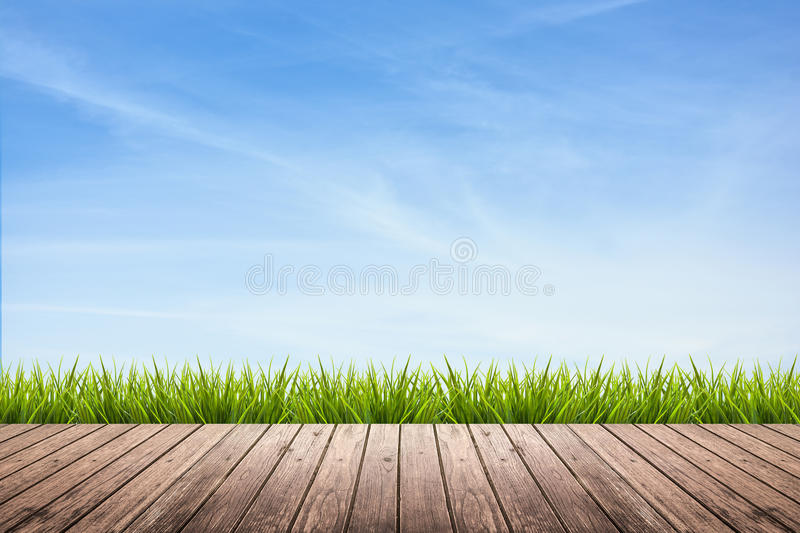 Wooden floor and grass under sky stock images