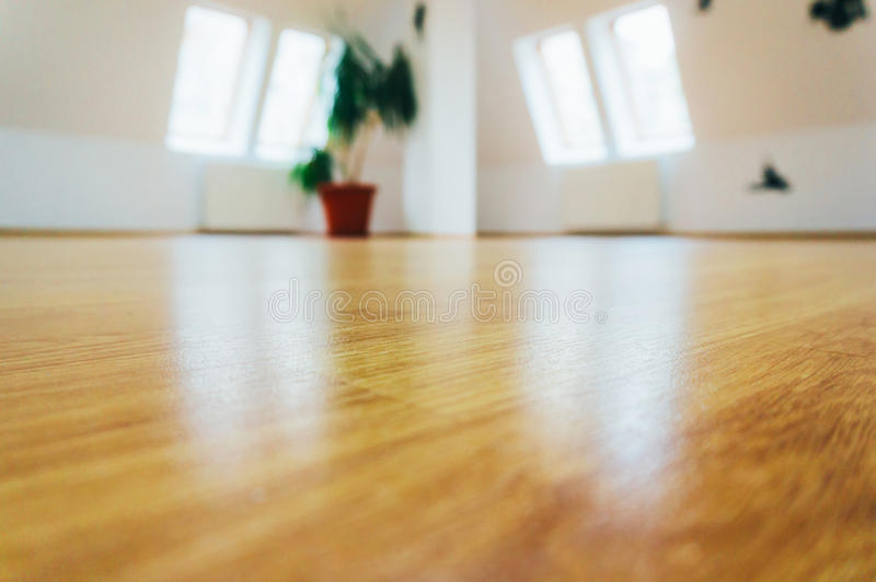 Wooden floor. Interior of modern home with white walls producing background blur of both walls and polished wooden floor stock images
