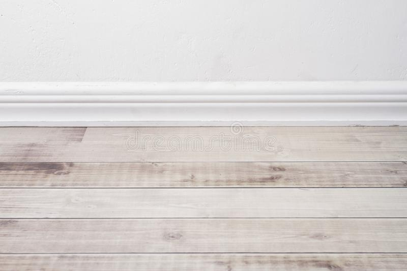 Wooden floor and plaster skirting board. Wooden floor and plaster skirting board royalty free stock photos