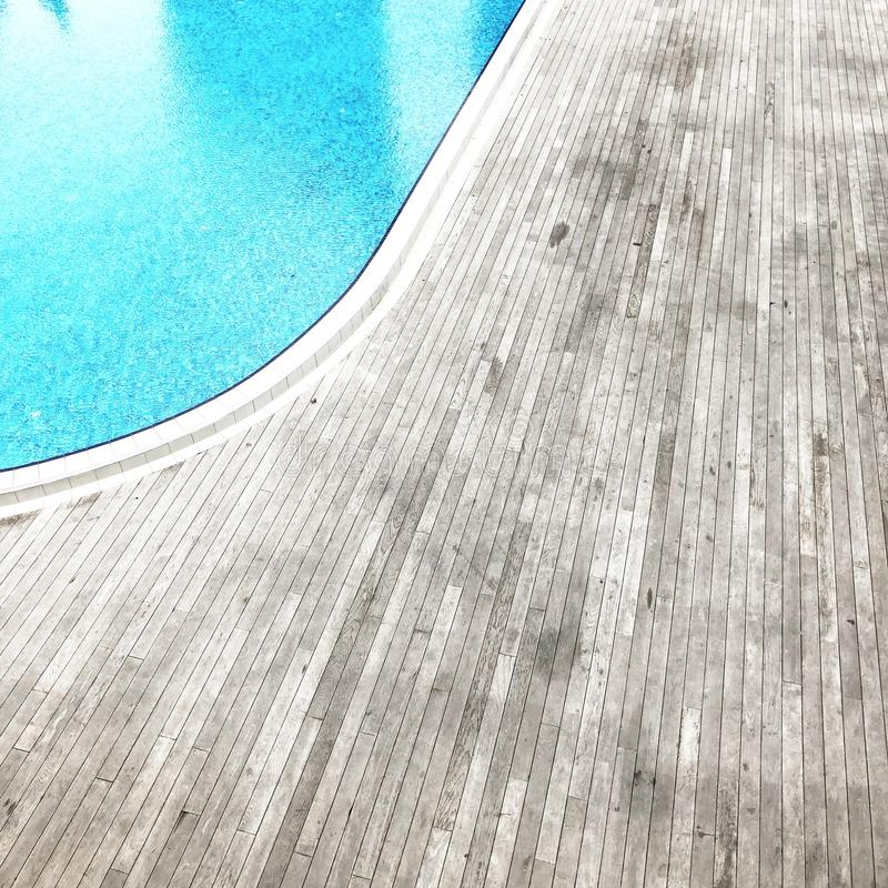 Wooden Floor Beside Pool stock photo
