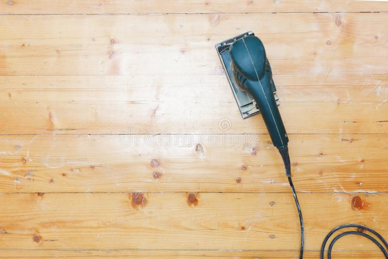 Wooden floor sanding with flat sander tool stock photography
