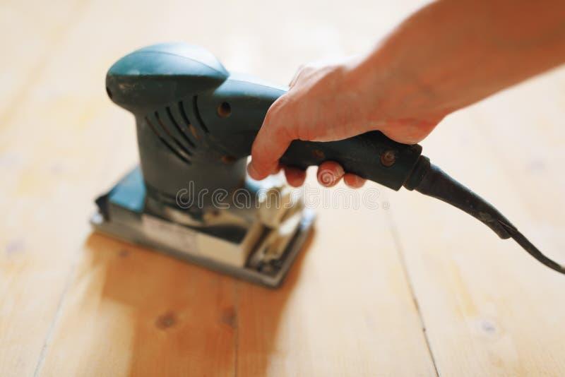 Wooden floor sanding with flat sander tool stock photo